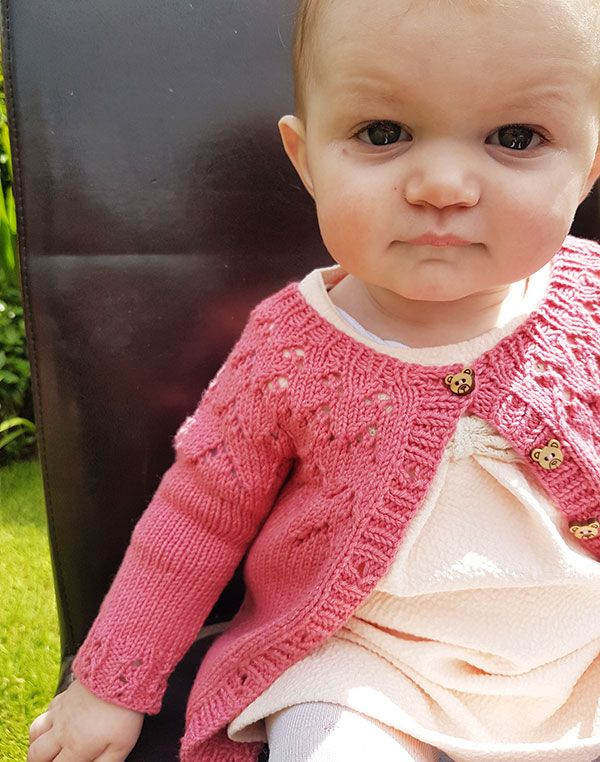 13d79087e ... cute and pretty baby cardigan that s versatile enough for a girl or a  boy. The simple lace design on the yoke adds interest. MATERIALS Yarn   Double knit ...