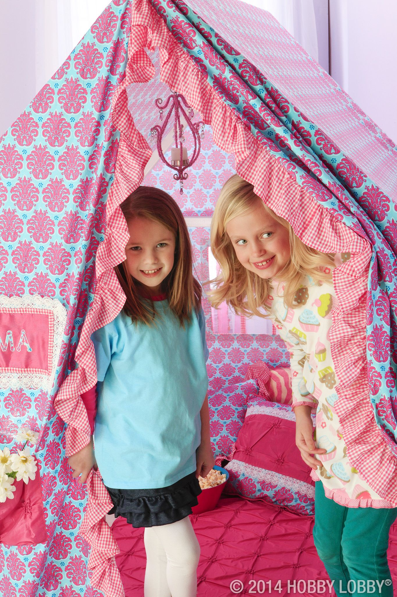 It's the mother of all play tents: house-shaped, pink from top to bottom and covered in frilly details. We pulled off the pretty with pink and blue damask, flirty coordinating gingham and a few pops of gorgeous puckered faux silk. Ahhh…welcome to girl world.