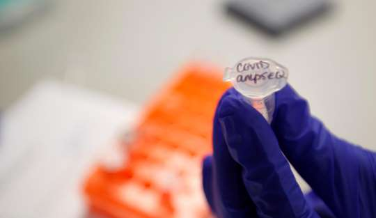 A worker at Translational Genomics Research Institute in