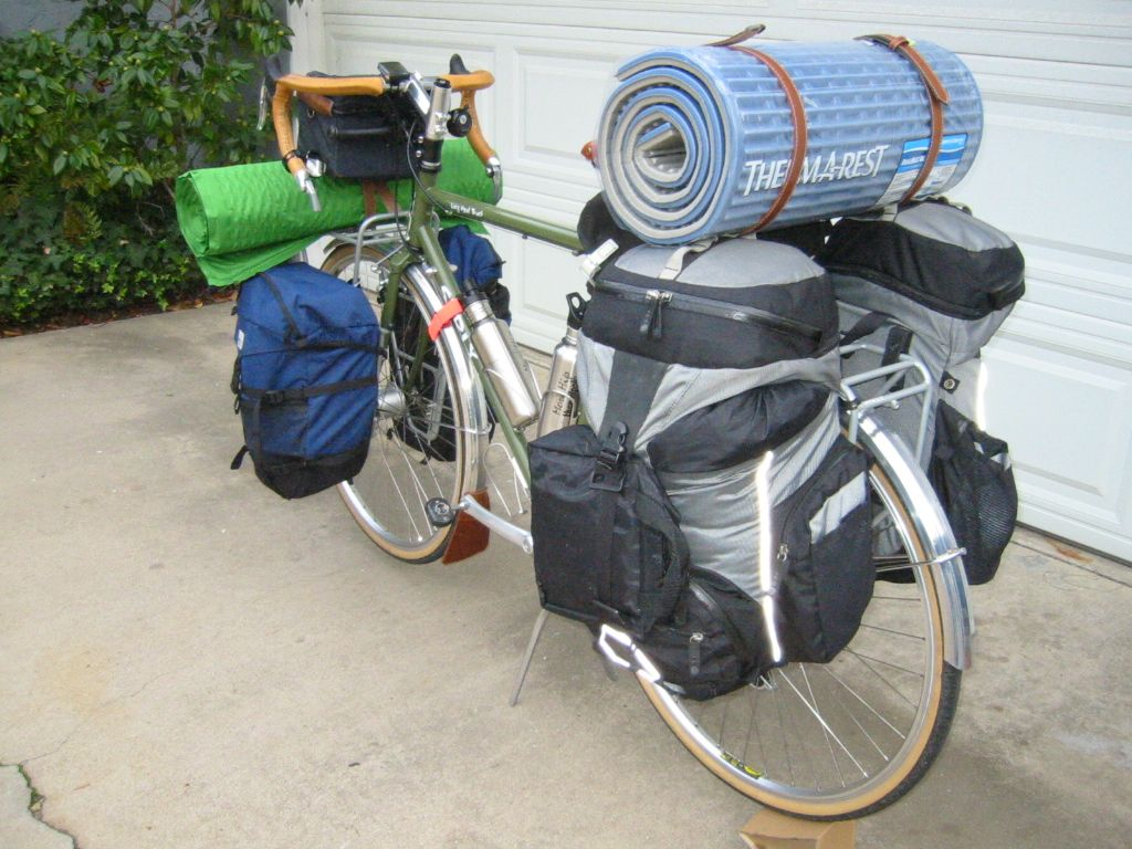 Um, does this guy have TWO massive sleeping mats or is that just me?  Now you see why it's nice to have small lightweight gear.  loaded touring bike