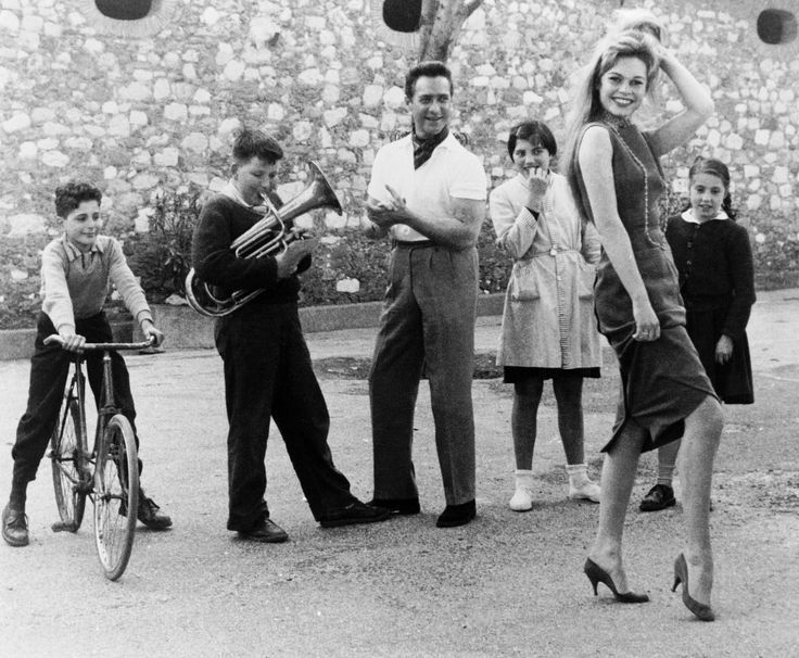 Richard Todd and French children  with Brigitte Bardot.