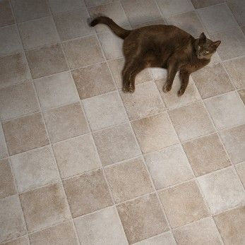 Classic tile squares, a rustic tumbled finish, gorgeous color variations, chiseled edges... and vinyl? Yes, it's all in our Seville flooring by Naturcor.