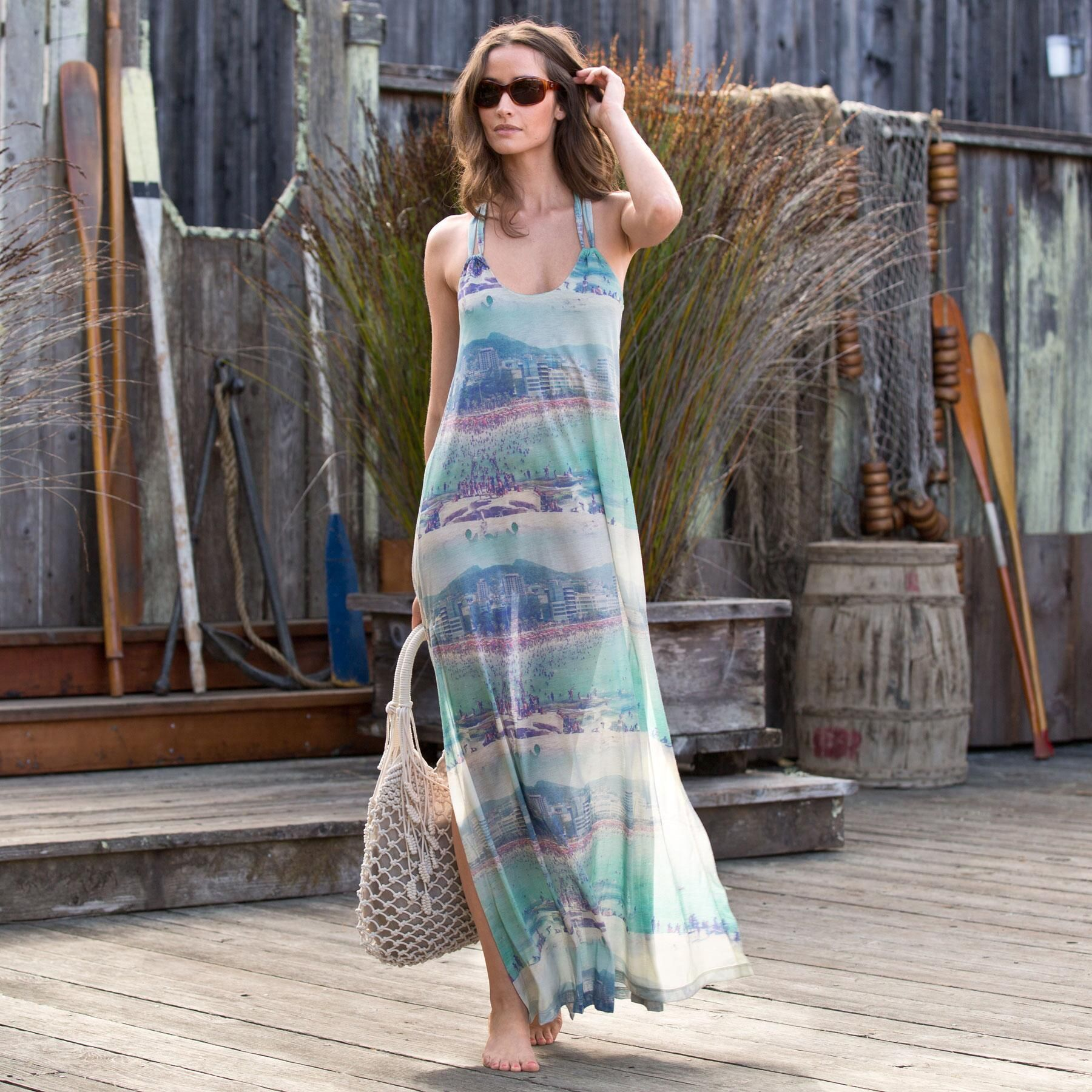 "RIO BEACHSCAPE MAXI DRESS -- Scenes of beachside Rio de Janeiro are printed like surreal stripes on a striking sweep of dress, suspended from straps that flow into a cut-out racer back. Wear it for a stroll by the sea or a supper under the stars. Polyester. Hand wash. Made in Brazil, reknowned for unbeatable beachwear. Sizes S (4 to 6), M (8 to 10), L (12 to 14), XL (16). 58-1/4""L."
