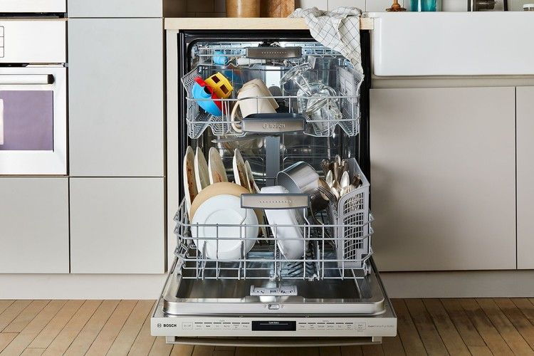 Handy Tips To Make Dishwasher Duty A Breeze Food52 Dishwasher Smell Clean Dishwasher Cleaning Appliances