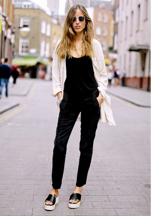 How to Wear a Jumpsuit—45 outfits to copy ASAP | Casual. Black jumpsuit, lightweight jacket, and platform sandals. Minimalist style.