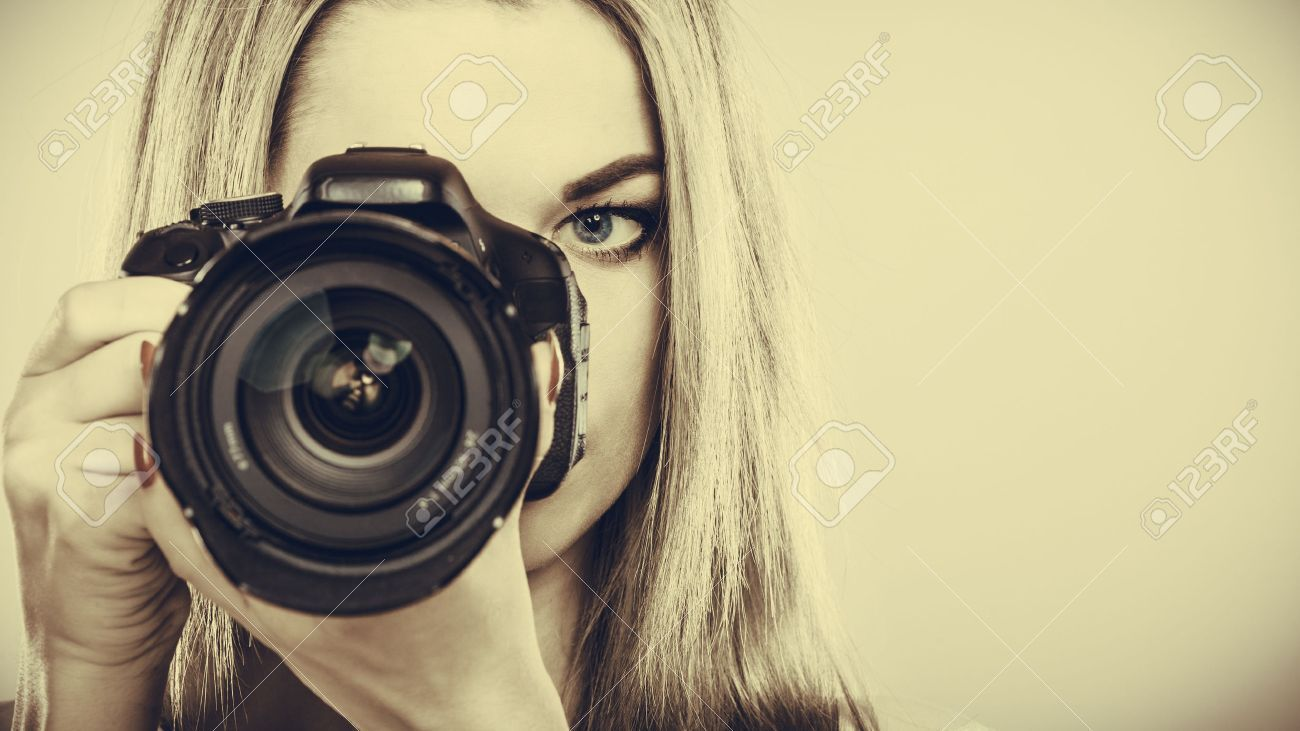 grapher girl shooting images Attractive blonde woman taking