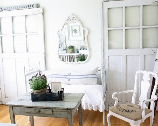 Vintage doors used to anchor a room. Green Design. Love.