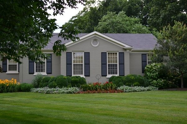 Grey painted brick ranch house love the color and the shutters