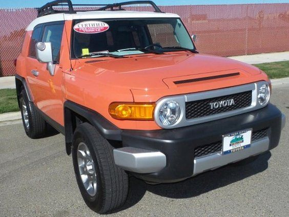Certified 2013 Toyota FJ Cruiser Base Exterior: Orange Status: In Stock  Mileage: 34261 Engine: Gas V6 4.0L/241 Transmission: Automatic