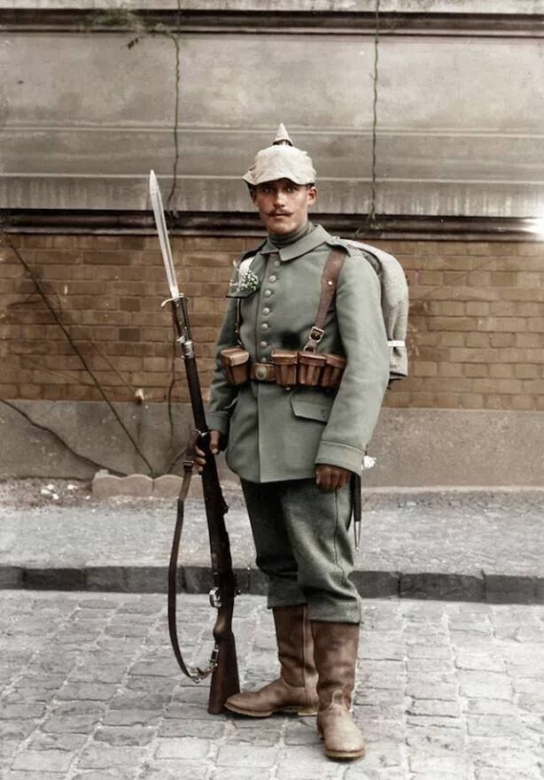DEUTSCHES HEER - An outstanding outdoors portrait of a Saxon infantryman with the 4th Regiment Royal Saxon army, 103 Infantry Regiment of the German Reich (Kgl. Sächs. 4. Infanterie-Regiment Nr.103), possibly taken in his garrison at Bautzen, eastern Saxony, circa 1916. He wears the model 1907/10 Feldrock tunic with the belt buckle with the Saxon motto, 'Providentiae Memor' (Providence Remember), and is armed with a Gew. 98 mauser rifle fitted with a S98/05 bayonet.