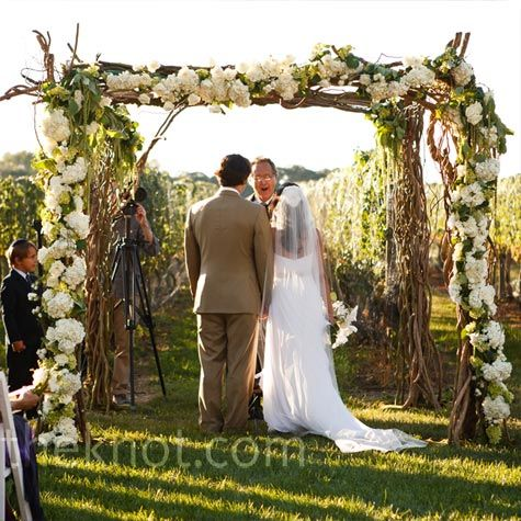 I don't think you need to be Jewish to get married under a huppah. Something like this is a gorgeous little love nest to have at the end of any aisle.