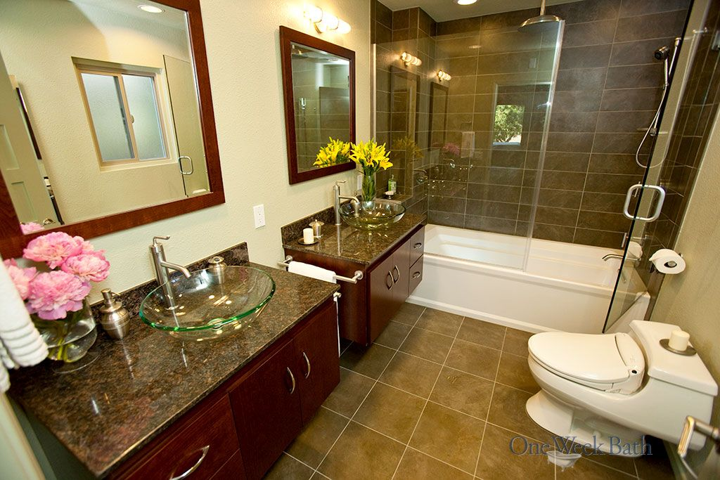 One Week Bath completed this full-size transitional bathroom remodel with low-profile toilet, granite counter vanities and step-in shower/tub combo. This bathroom design combines both traditional and contemporary bathroom styles in dark but neutral colors. Let us create your perfect bathroom sanctuary in, yes, one week. #OneWeekBath #Bathroom #Remodel