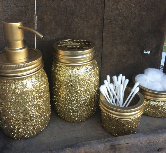 Gold glitter mason jar bathroom set with toothbrush   flower vase holder  and soap dispenser cotton ball and q tip holder   can also add clock    trash can. Gold glitter mason jar bathroom set Soap dispenser also have the