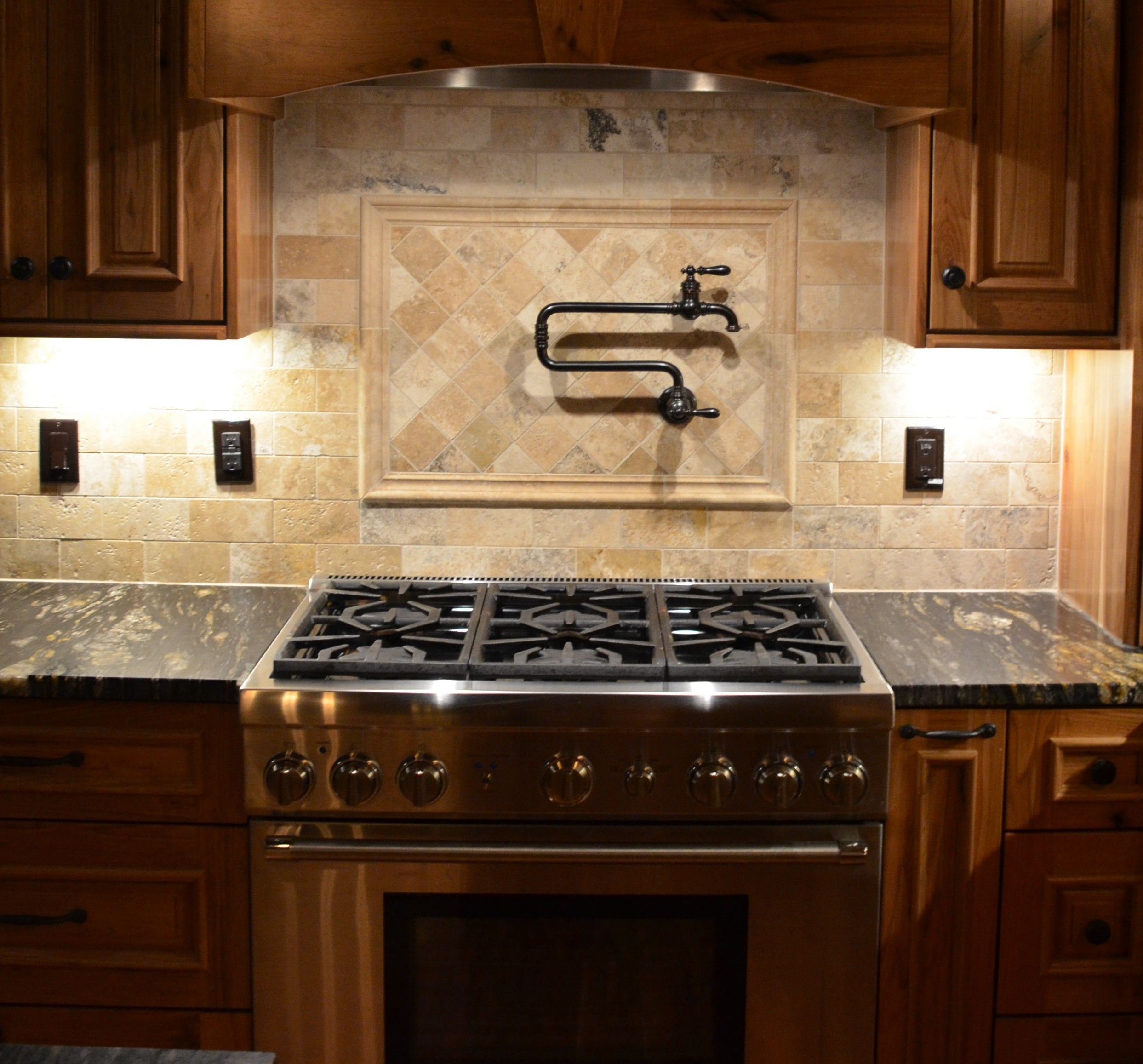Rustic Butternut Kitchen With Travertine Tile Backsplash And Pot Filler Travertine Tile Backsplash Travertine Tile Kitchen