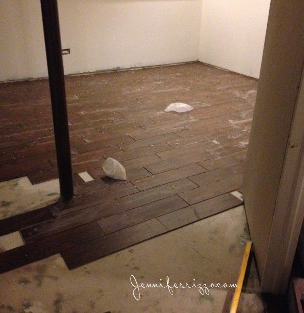 Installation Of Wood Look Cermic Tile On A Basement Floor