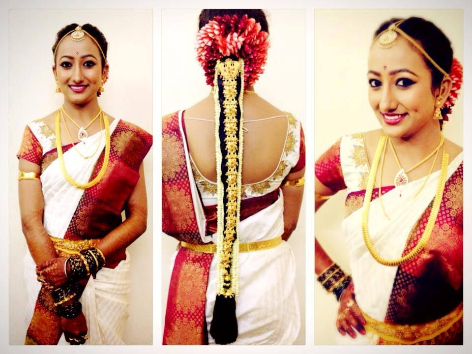 Traditional South Indian bride wearing bridal saree, hairstyle and ...