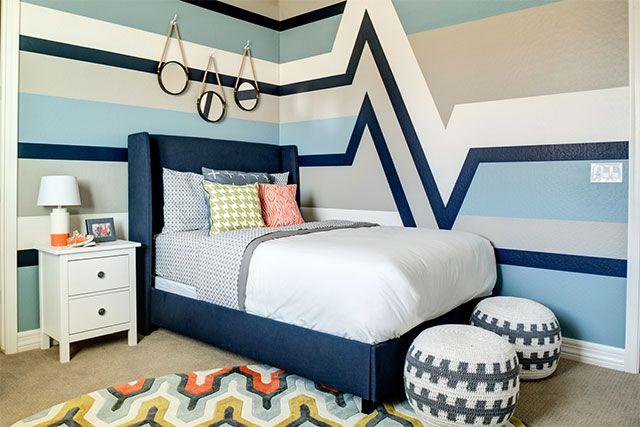 What a fun #bigboyroom! We love the heartbeat stripe design on the wall. #kidsroom