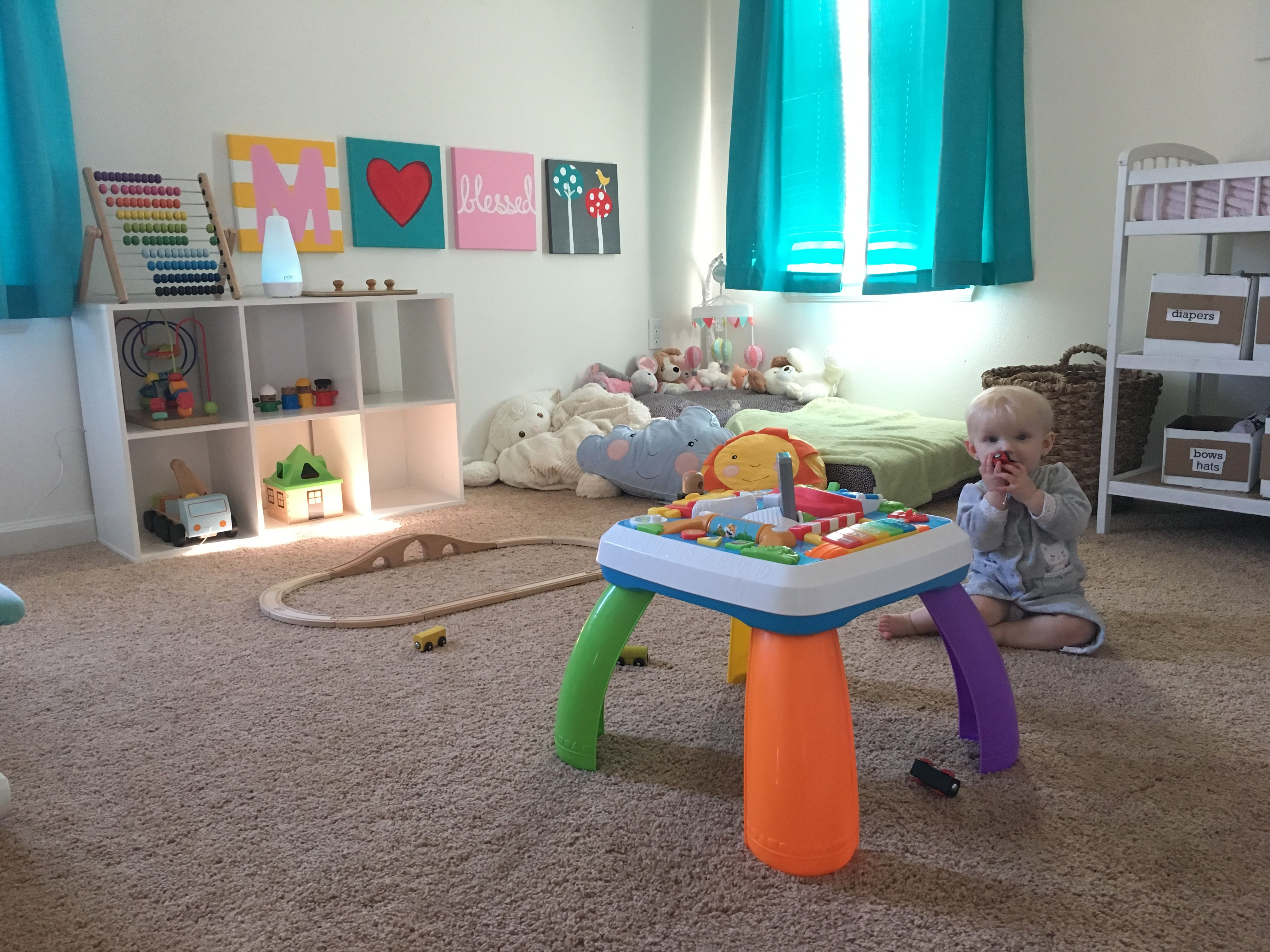 Montessori baby room at 8 months.