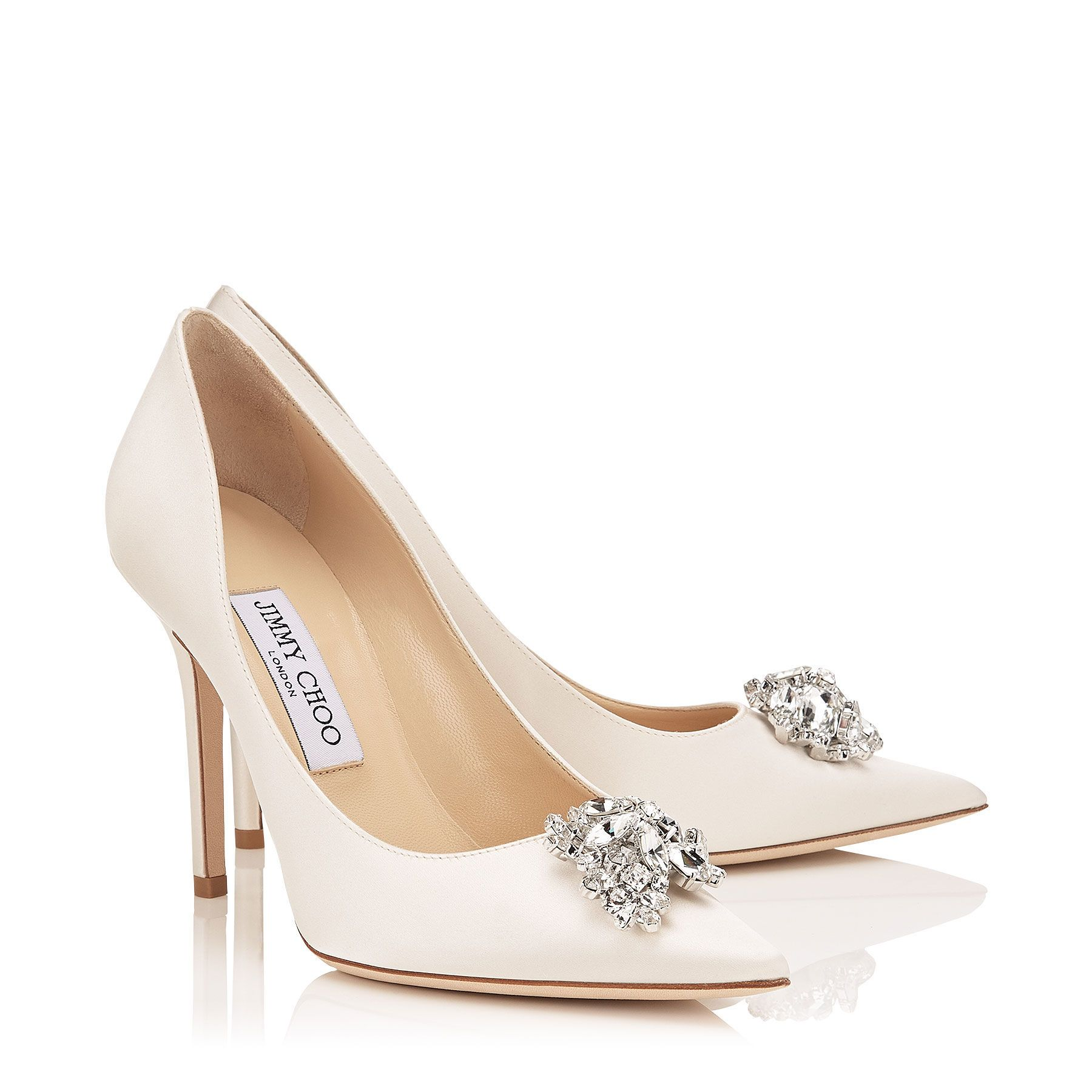 7088d27f7f9d ABEL Ivory Satin Pointy Toe Pumps with Crystal Detail