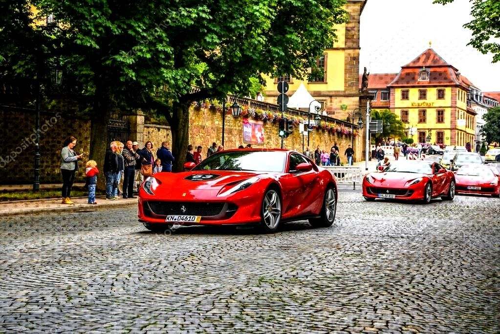 GERMANY, FULDA - JUL 2019: red FERRARI 812 SUPERFAST Type F152M is a front mid-e ,