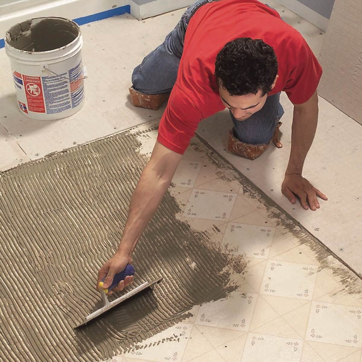 How To Lay Tile Install A Ceramic Tile Floor In The Bathroom The Family Handyman Ceramic Floor Tiles Ceramic Tile Bathrooms Tile Installation