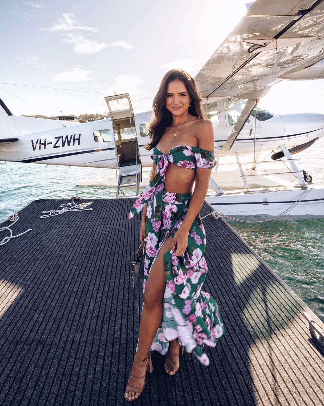 "Helen Owen on Instagram: ""Uber's here 🛩💦 wearing @loversfriendsla @revolve #revolvearoundtheworld"""