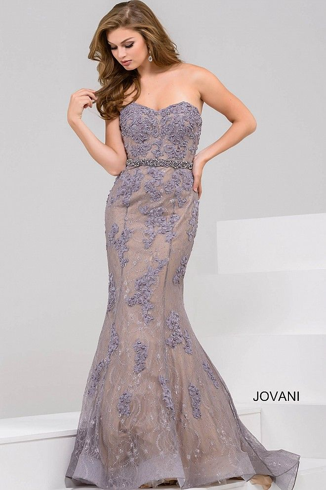 fb63d2627b77 This Jovani 33261 evening dress features a mermaid silhouette with a strapless  sweetheart neckline, embellished with lace appliques and a beaded waistband.