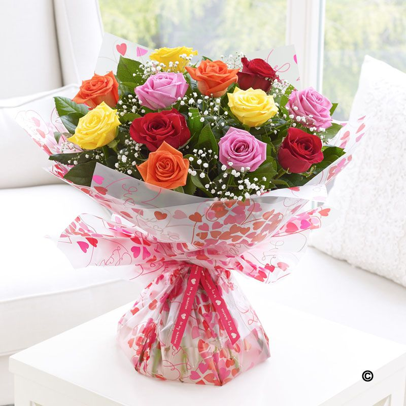 stunning mixed coloured roses with gypsophilia , perfect to ...