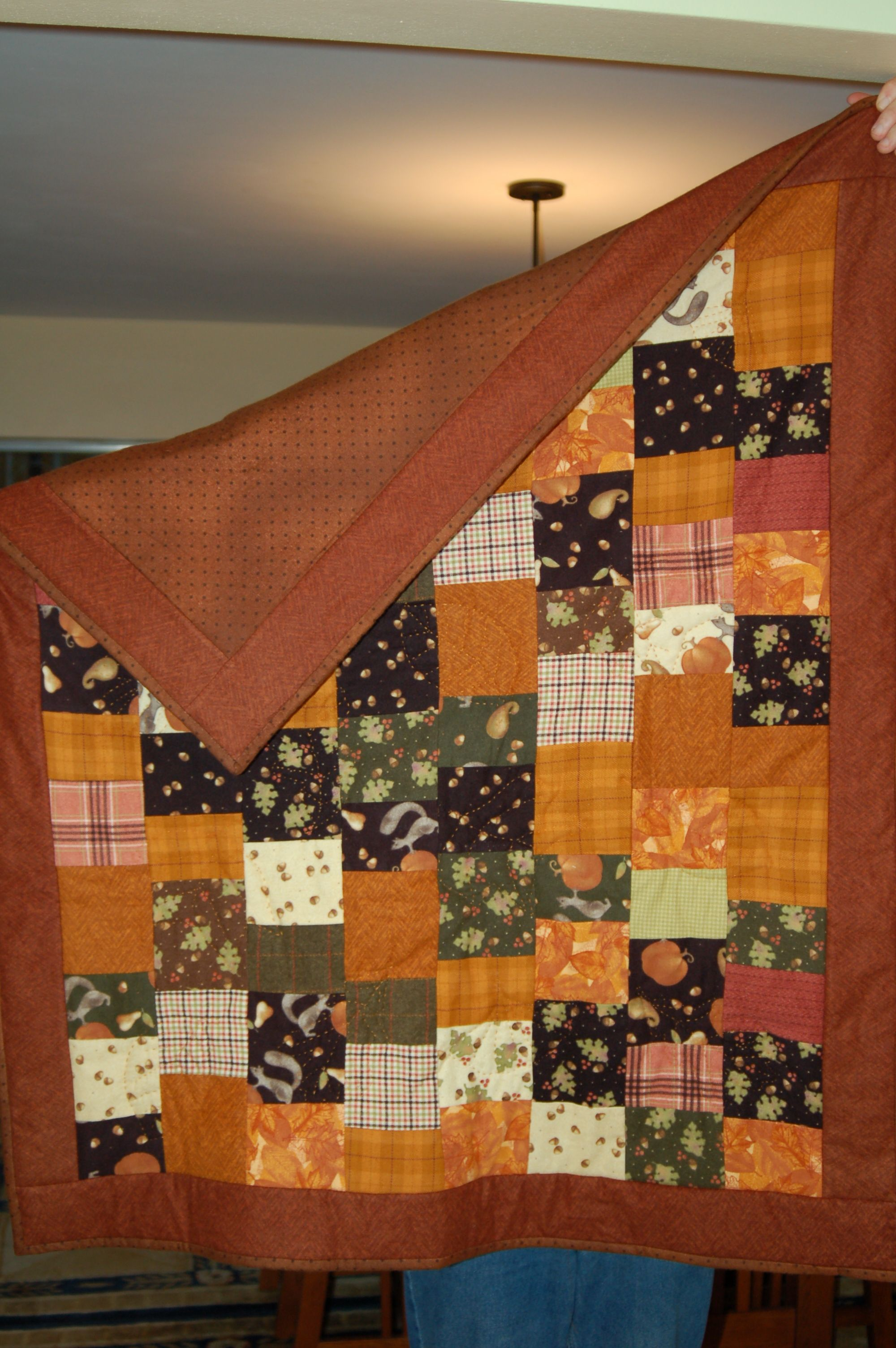 flannel quilt I made for third grandson, quilted with 5 different leave shapes using embroidery floss