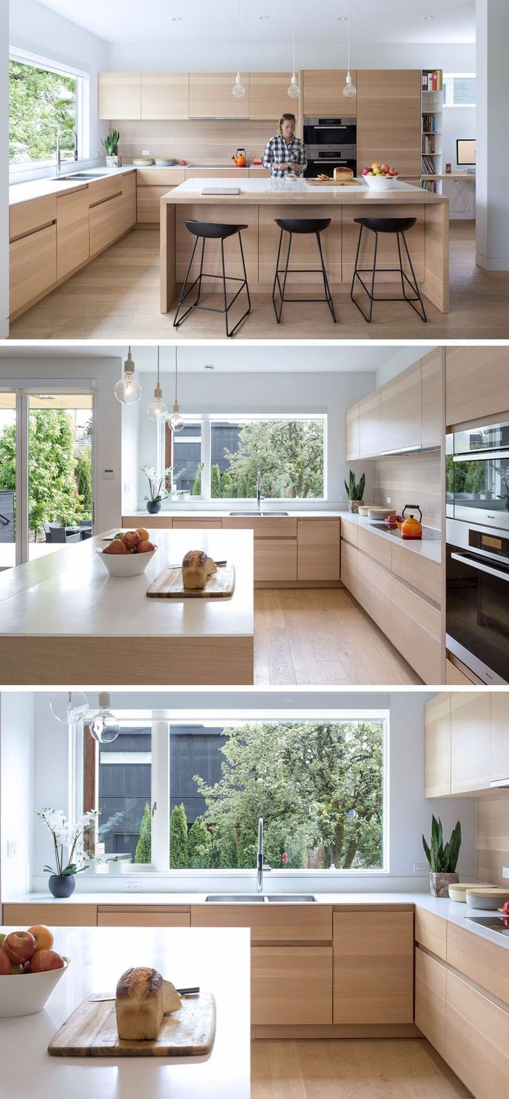 In this kitchen, a large window provides lots of natural light to ...