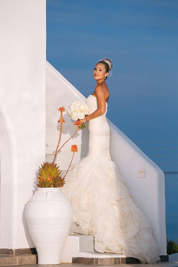 Bride in a Vera Wang wedding dress at Rocabella Santorini ...