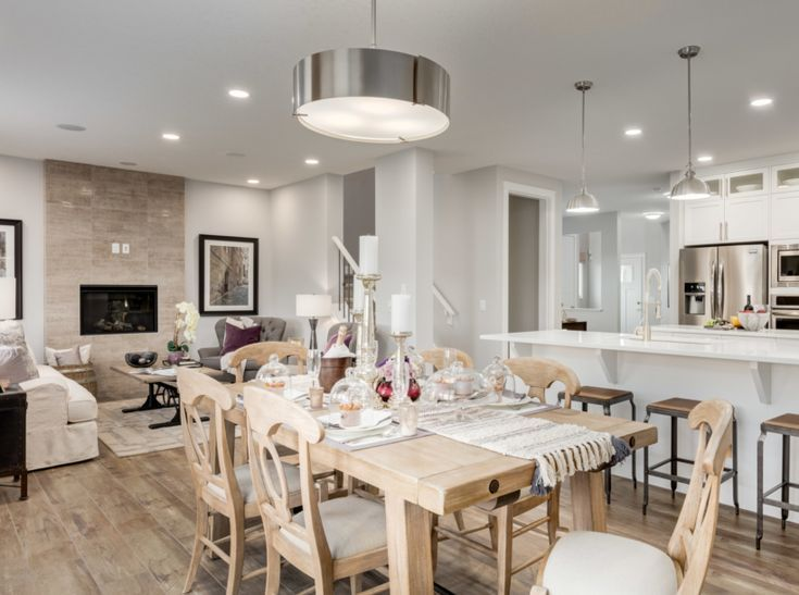 Dining room and kitchen. View more of this home: Kingston Mhgy Main Floor  | Home design by Excel Homes  #diningroom #homedecor #homebuilder #diningroomtable #diningroomnook #moderndecor