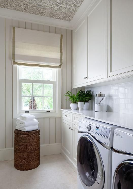 Chic Laundry Room Features A Ceiling Clad In Nina Campbell Elcho