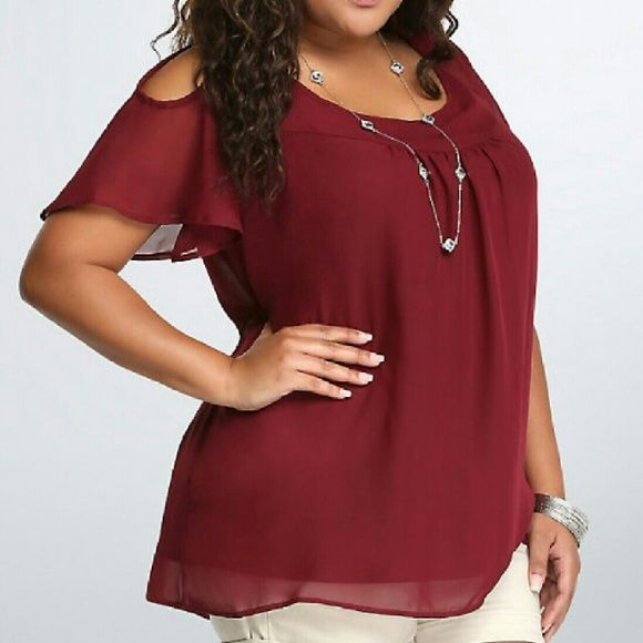 Cold Shoulder Torrid Blouse Cold Shoulder Torrid Blouse. Cranberry in color. Torrid size 5 = 26/28. Super Cute shirt. Never worn. No trades. Make me an offer. torrid Tops Blouses