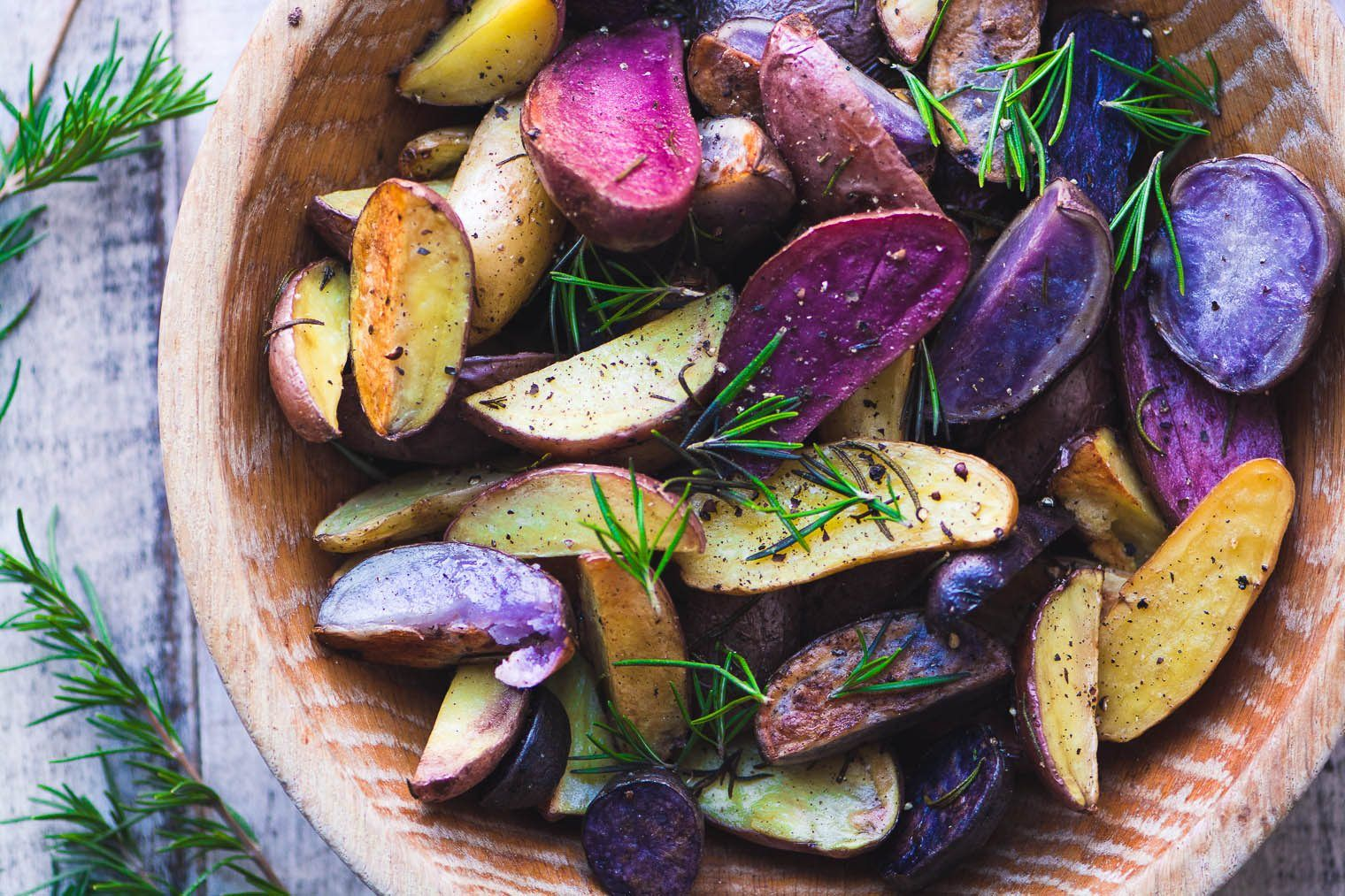 Rosemary Roasted Rainbow Potatoes are a colorful and easy side dish that brings some excitement to the table, and they're no more trouble to make than regular roasted potatoes. #sidedish #rainbow #newpotatoes #roastedpotatoes #easysidedish #dinner #redpotatoes #bluepotatoes #purplepotatoes #recipe #easy