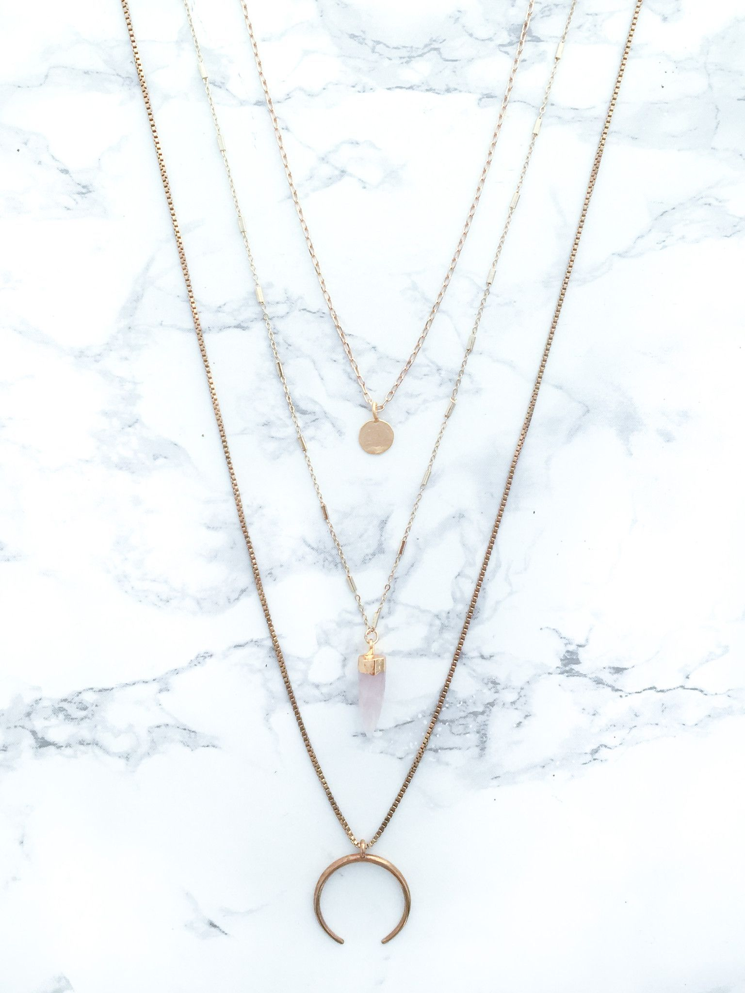 A long gold plated ox horn layered necklace is a simple and modern