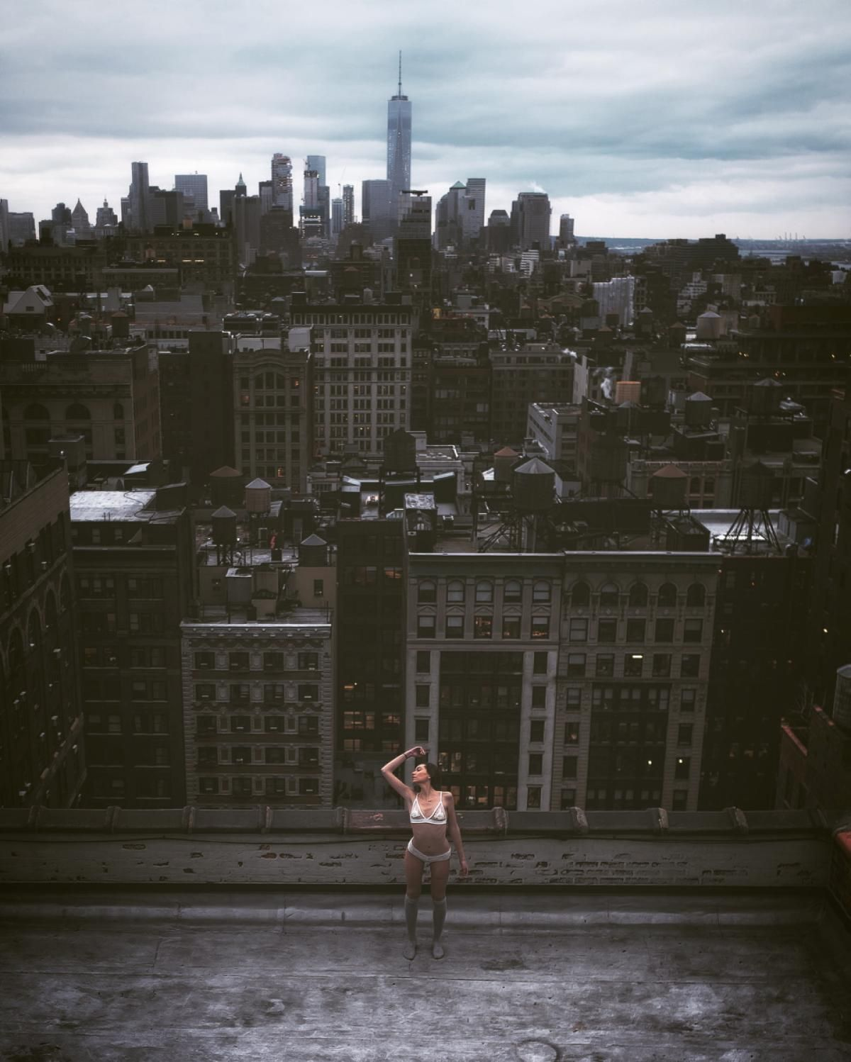 Standing before Downtown Manhattan in line with the Freedom Tower, a model appears at one with the city as she strikes a pose in just her lingerie in this brave and powerful shot featured in Mar Shirasuna's photo series.