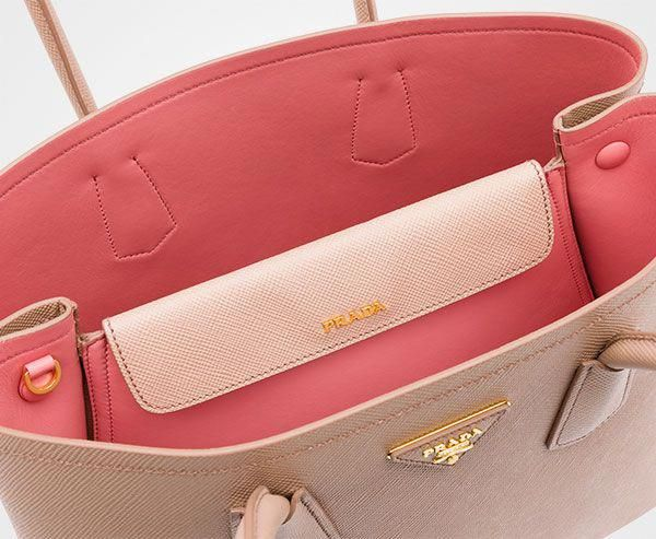 4f4213552e25 The double opening on a square-ish bag has always been Prada's thing.  Description from purseblog.com. I searched for this on bing.c… | What's In  My Bag