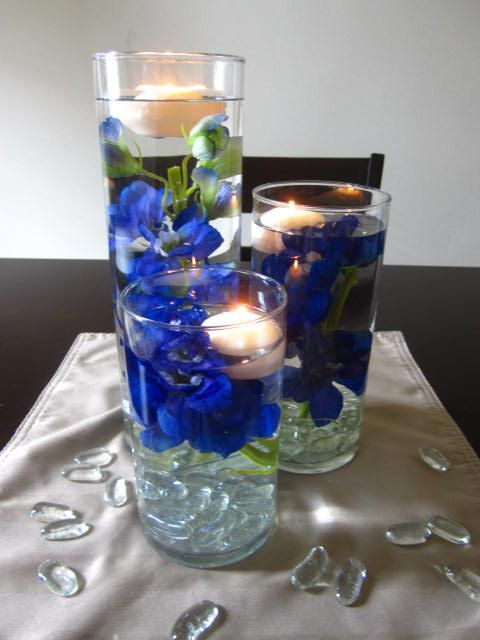 Purple and blue flower floating candle wedding centerpiece