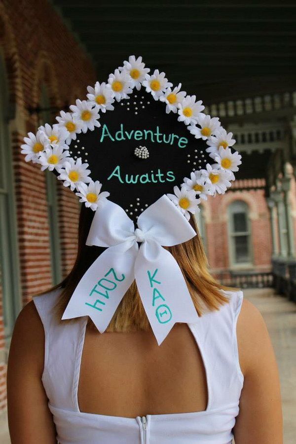 Graduation Cap Decorated with Flowers and a Bow. | Graduation cap decoration, Graduation cap designs