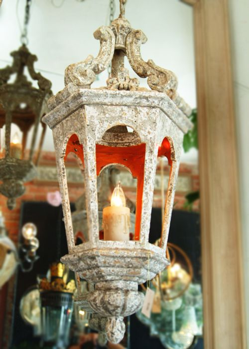 Antique Stone Chandelier with Orange Interior.
