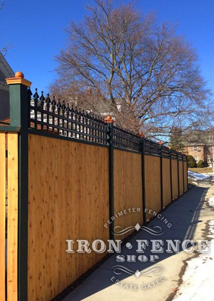 A Custom 2ft Tall Iron Fence Panel Used As An Accent Piece On Top