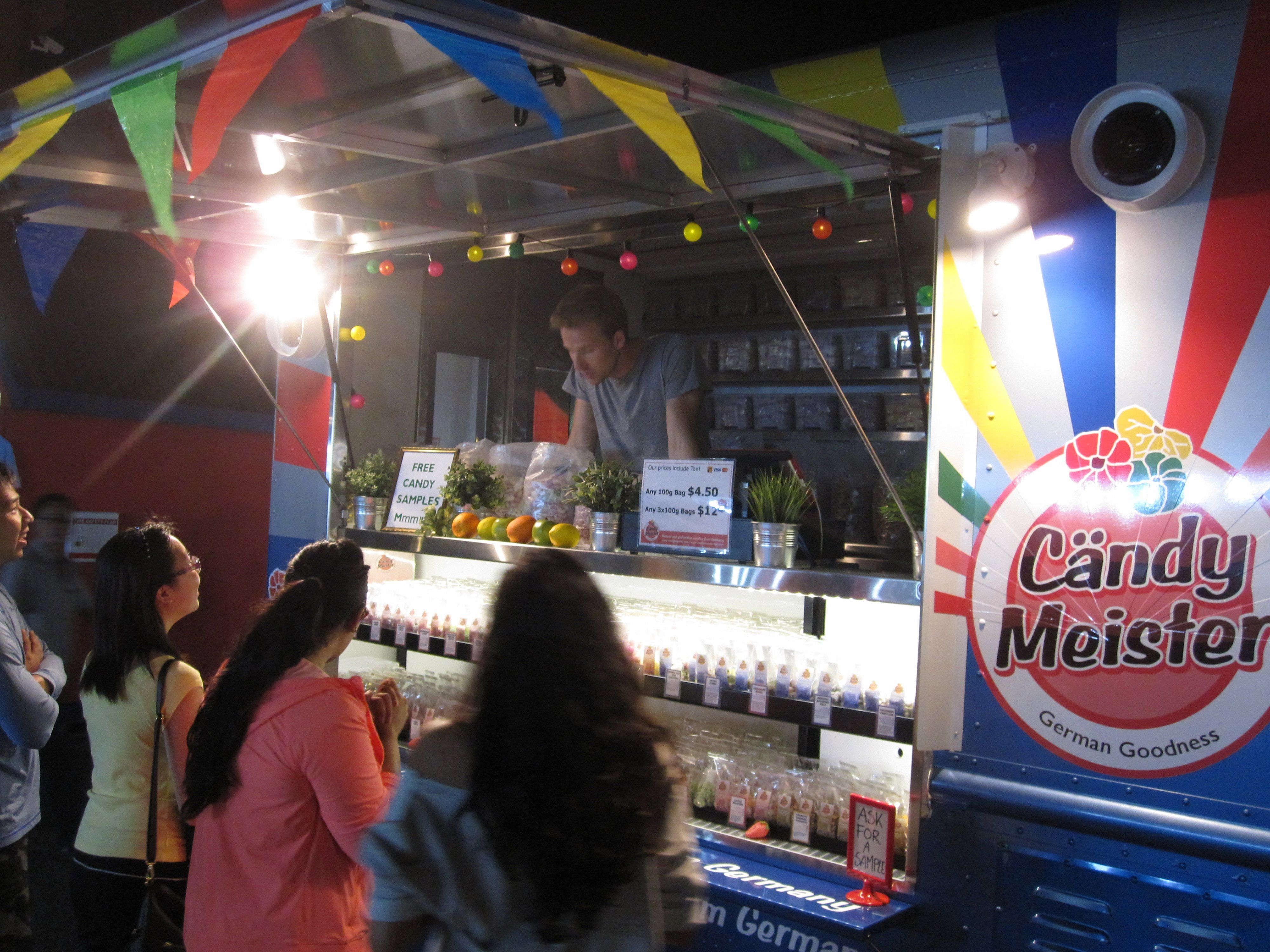 Here we are on the first night of the job. During our soft launch weekend, we were at the Richmond Summer International Night Market, giving away samples of so many of our different candies. Raspberry, lemons, orange slices...too many to name, but too good to pass up. Visit us at www.candy-meister-van.com to find out where we'll be next.