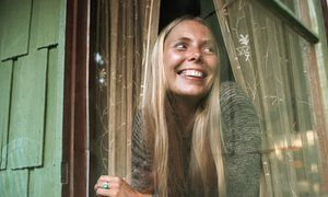Joni Mitchell looks out a window of her Laurel Canyon home in October 1970.