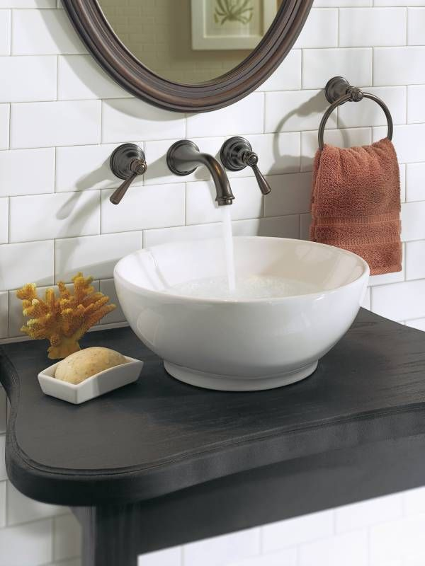 Kingsley Oil Rubbed Bronze Two Handle Low Arc Wall Mount Bathroom