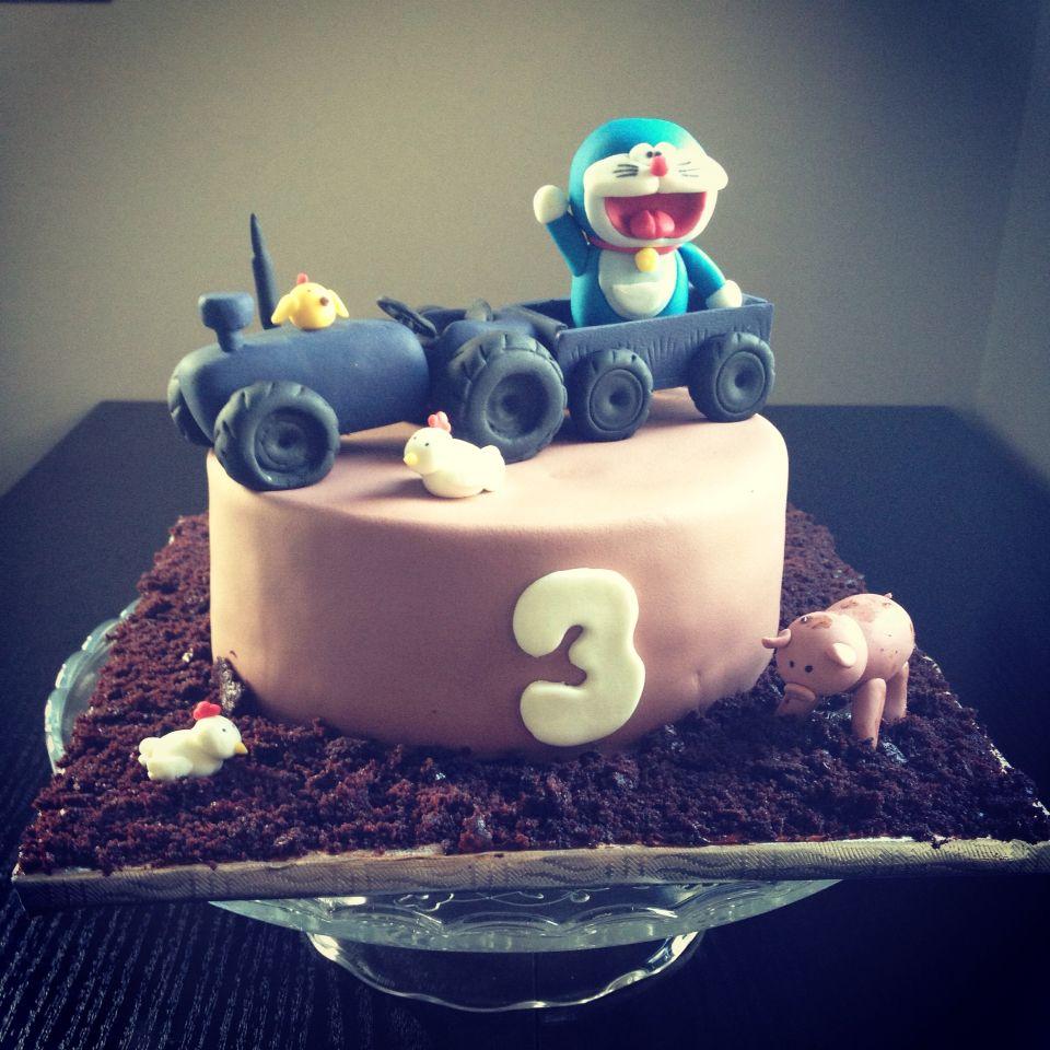 Tractor and Doraemon cake