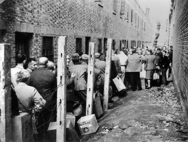Shanghai, China, A line at the entrance to a Jewish refugee camp.