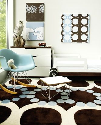child's room, nursery from avalisa.com    eames turquoise blue rocking chair, blue and brown circles rug, blue and brown art, table and white modern chest