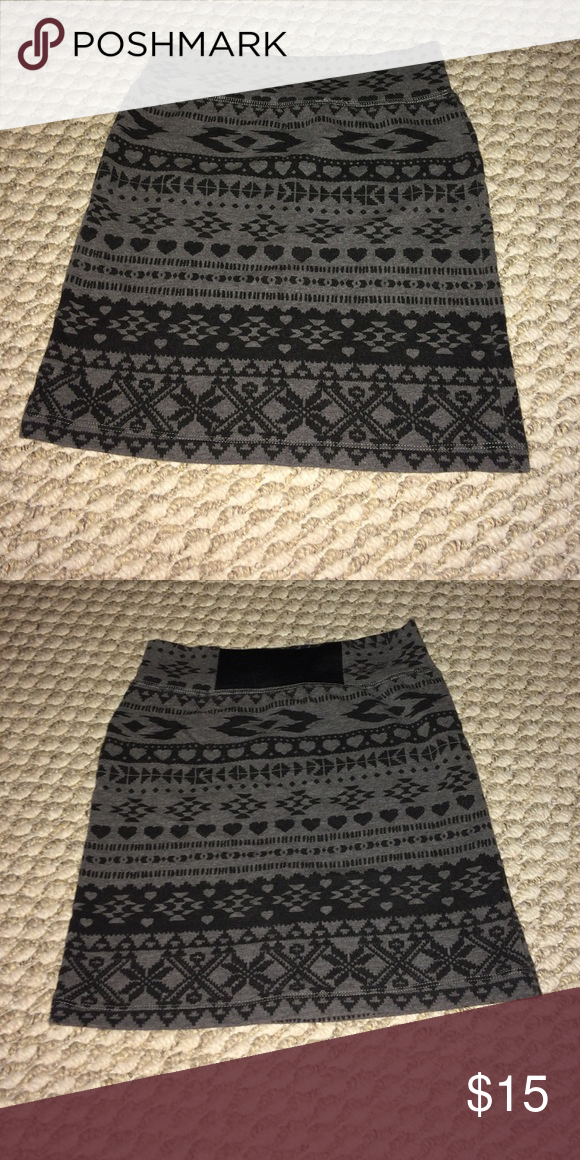 Pencil skirt Cute gray and black pencil skirt from Garage. Bought but unfortunately I was never able to fit into it. NWOT and has NEVER been worn. Must go! Garage Skirts
