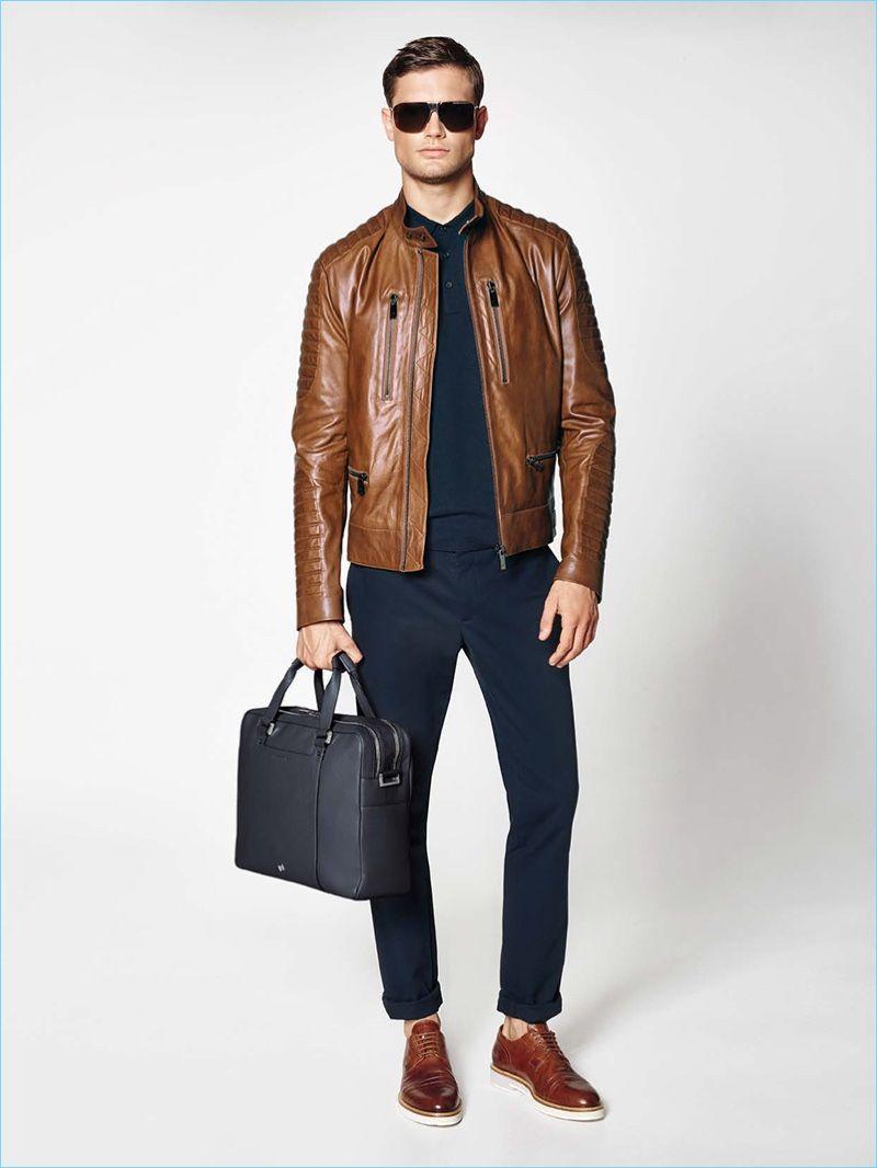 Porsche Design taps into moto style with a must-have motocross jacket in  brown leather. The luxurious piece complements a navy polo shirt 286d6da13c2